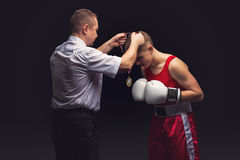 Boxing referee gives medal to young boxer Royalty Free Stock Image