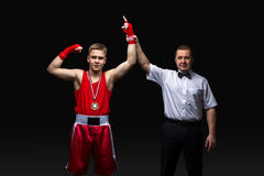 Boxing referee gives medal to young boxer Stock Photography