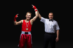Boxing referee gives medal to young boxer Stock Images