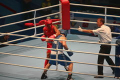 Boxing referee makes admonition to  boxer Stock Image