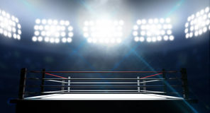 Boxing Ring In Arena. An boxing ring surrounded by ropes spotlit by floodlights in an arena setting at night Royalty Free Stock Photography