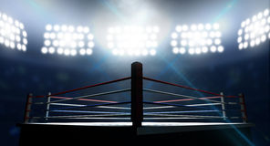 Boxing Ring In Arena. An boxing ring surrounded by ropes spotlit by floodlights in an arena setting at night Stock Photography