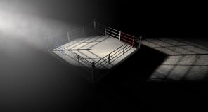Boxing Ring Corner Lit. A 3D render of a modern boxing ring with a blue and red area spotlit dramatically on one corner on an  dark background Royalty Free Stock Image