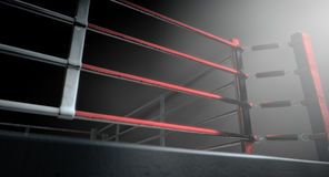 Boxing Ring Corner Lit. A 3D render of a modern boxing ring with a blue and red area spotlit dramatically on one corner on an isolated dark background Stock Photos