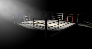 Boxing Ring Corner Lit. A 3D render of a modern boxing ring with a blue and red area spotlit dramatically on one corner on an isolated dark background Royalty Free Stock Images