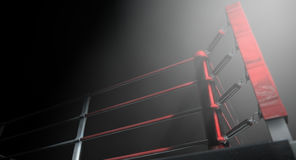 Boxing Ring Corner Lit. A 3D render of a modern boxing ring with a blue and red area spotlit dramatically on one corner on an isolated dark background Royalty Free Stock Photography