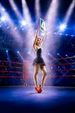 Boxing ring girl  is holding the number Royalty Free Stock Photos