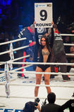 Boxing ring girls holding a board with round number Royalty Free Stock Images
