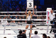 Boxing ring girls holding a board with round number Stock Images
