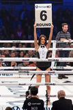 Boxing ring girls holding a board with round number Royalty Free Stock Photo