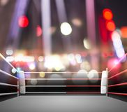 Boxing ring with illumination by spotlights. digital effect 3d r Royalty Free Stock Photo