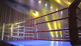 Boxing ring in lights of projectors stock video footage
