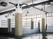 Boxing ring and punching bags in a gym interior. 3d rendering Stock Image