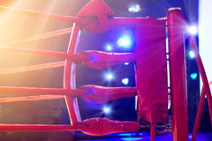 Boxing ring red corner and floodlights. Dramatic lighting Royalty Free Stock Photo