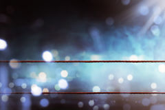 Boxing ring ropes. With a blur spotlight Stock Photo