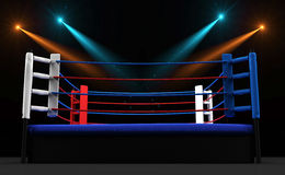 Boxing ring with spotlight isolated on dark background Stock Images