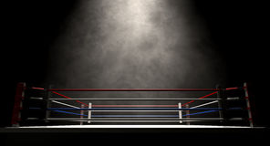 Boxing Ring Spotlit Dark. A regular boxing ring surrounded by ropes spotlit in the missle on an isolated dark background Stock Image