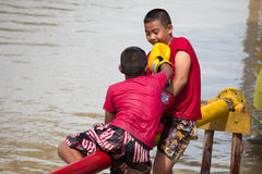 Boxing on the sea with thai style. 2 boys boxing on the sea with thai style stock photography