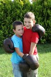 Boxing sibling. Children fighting with boxing gloves. Sibling, two boys boxing Stock Photography