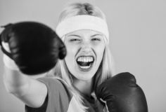 Boxing sport concept. Cardio boxing exercises to lose weight. Woman exercising with boxing gloves. Girl learn how defend stock images