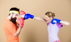 Boxing sport concept. Couple girl and hipster practicing boxing. Sport for everyone. Amateur boxing club. Equal. Possibilities. Strength and power. Ready to stock image