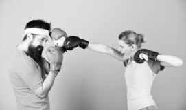 Boxing sport concept. Couple girl and hipster practicing boxing. Sport for everyone. Amateur boxing club. Equal royalty free stock images