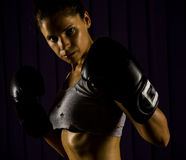 Boxing, strong, fit woman. Strong fit woman with boxing gloves preparing to fight Stock Images