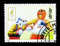 Boxing, Summer Olympics 1996, Atlantaserie, circa 1996. MOSCOW, RUSSIA - NOVEMBER 26, 2017: A stamp printed in Mongolia shows Boxing, Summer Olympics 1996 Royalty Free Stock Photo