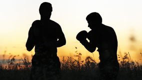 Boxing training outdoors stock video