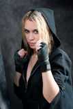 Boxing training woman in black grunge background Royalty Free Stock Image