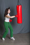 Boxing training woman with punching bag in gym. Wear gloves Stock Photo
