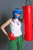 Boxing training woman with punching bag in gym. Wear gloves Stock Images