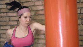 Boxing training woman with punching bag stock video