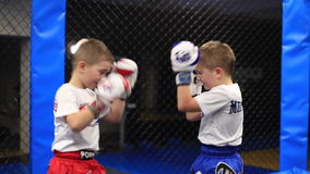 Boxing of two twins stock footage