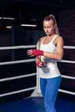 Boxing woman binds the bandage on hand Royalty Free Stock Image