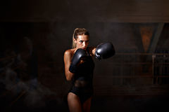 Boxing woman in black body Stock Images