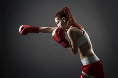 Boxing woman during exercise Royalty Free Stock Photography