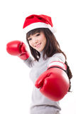 Boxing woman wearing christmas santa hat Royalty Free Stock Image