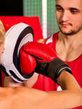 Boxing workout woman in fitness class. Sport exercise two people. Royalty Free Stock Image