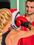 Boxing workout woman in fitness class. Sport exercise two people. Stock Photo