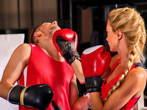Boxing workout woman in fitness class. Sport exercise two people. Stock Photos