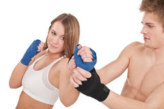 Boxing - Young woman in class training on white Royalty Free Stock Photo