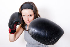 Boxing young woman. Boxing young women on light background Royalty Free Stock Photos