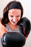 Boxing young woman. On light background Stock Photo