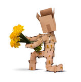 Boxman on bended knee with flowers Stock Photography