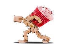 Boxman carrying a massive cupcake Royalty Free Stock Image