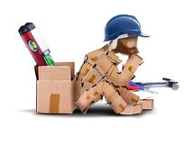 Box character handyman character sat thinking. Box character workman with hard hat sat resting against a toolbox. bearded worker and tools isolated concept Stock Images