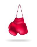 Boxninghandskar på en spika Arkivbild