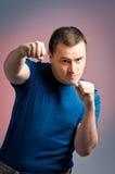 boxningman som plattforer ung Arkivfoto