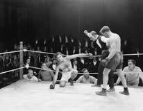 Boxningmatch (alla visade personer inte är längre uppehälle, och inget gods finns Leverantörgarantier att det inte ska finnas någ Arkivbilder